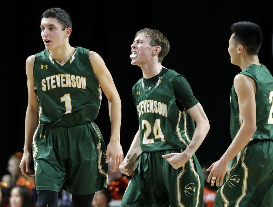 Stevenson's Matthew Ambrose (24) reacts after hitting a late 3-pointer during the Class 4A boys basketball supersectional Tuesday night at the Sears Centre in Hoffman Estates.