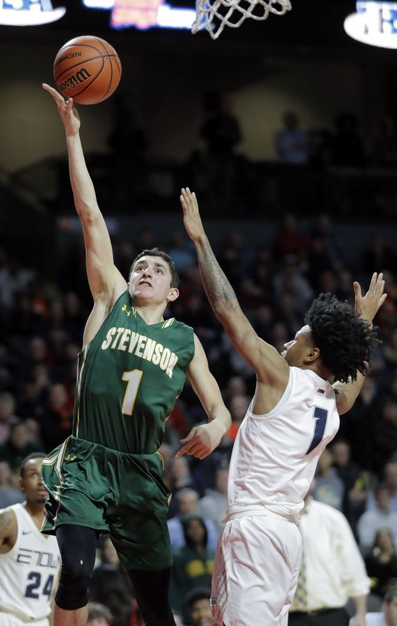 Stevenson's John Ittounas drives on Evanston's Jaheim Holden during the Class 4A boys basketball supersectional Tuesday night at the Sears Centre in Hoffman Estates.