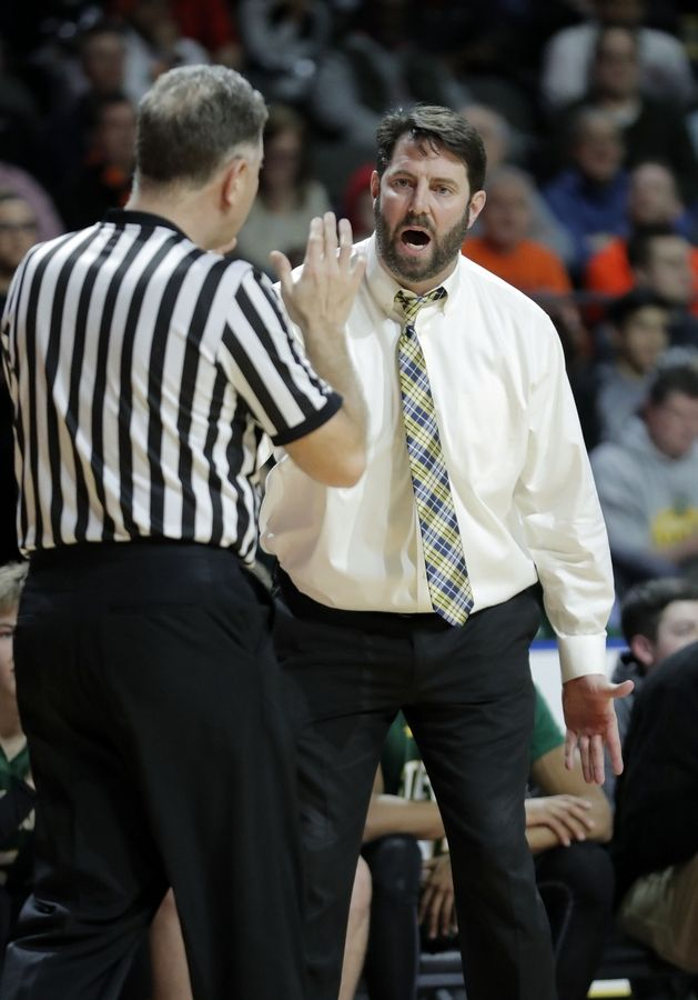 Stevenson head coach Pat Ambrose argues a call during the Class 4A boys basketball supersectional Tuesday night at the Sears Centre in Hoffman Estates.