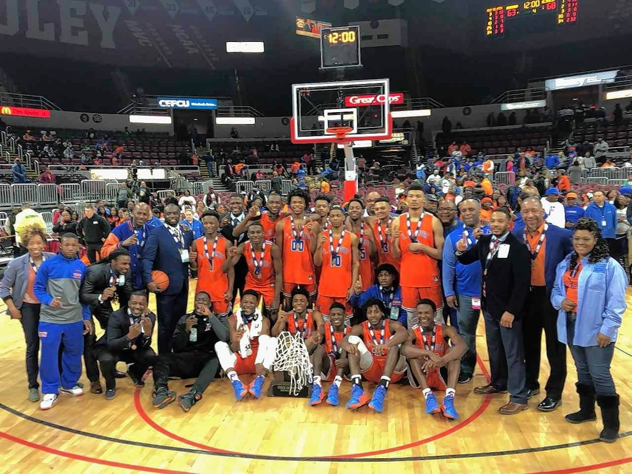 The East St. Louis Flyers pose with their Class 3A state championship trophy Saturday at Carver Arena in Peoria. The Flyers downed Chicago Bogan 68-63 in overtime to win the program's first state title.