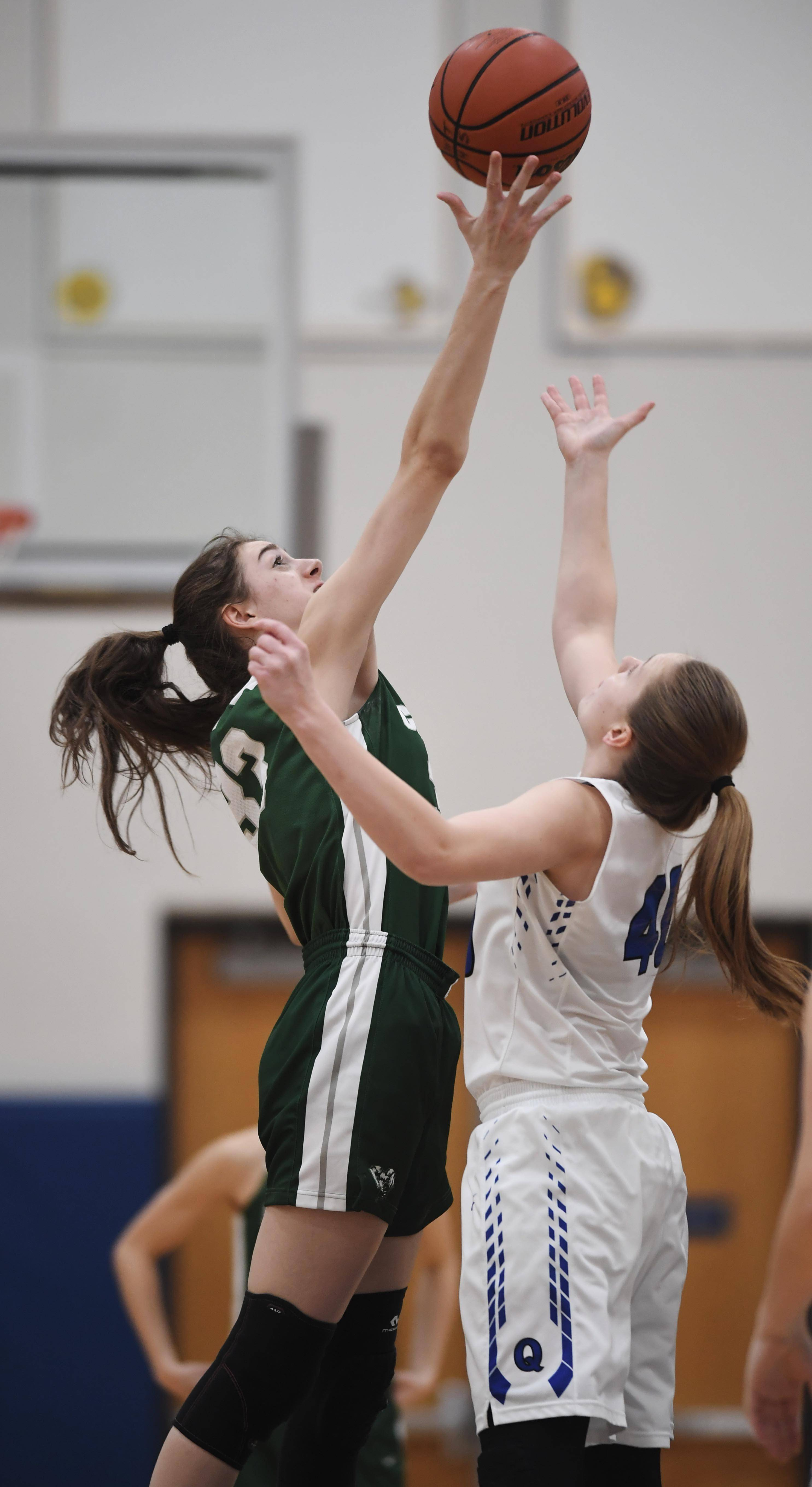Grayslake Central's Kate Bullman, left, wins the opening tip against Quincy's Sarah Nelson during the Warren Blue Devil Classic last season.