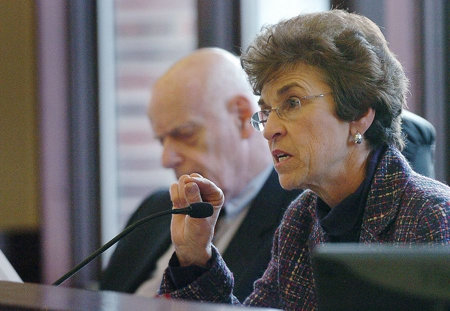 Arlington Heights Mayor Arlene Mulder makes a point during a meeting in 2011 at the village hall. She's with longtime village attorney Jack Siegel, who died in 2014.
