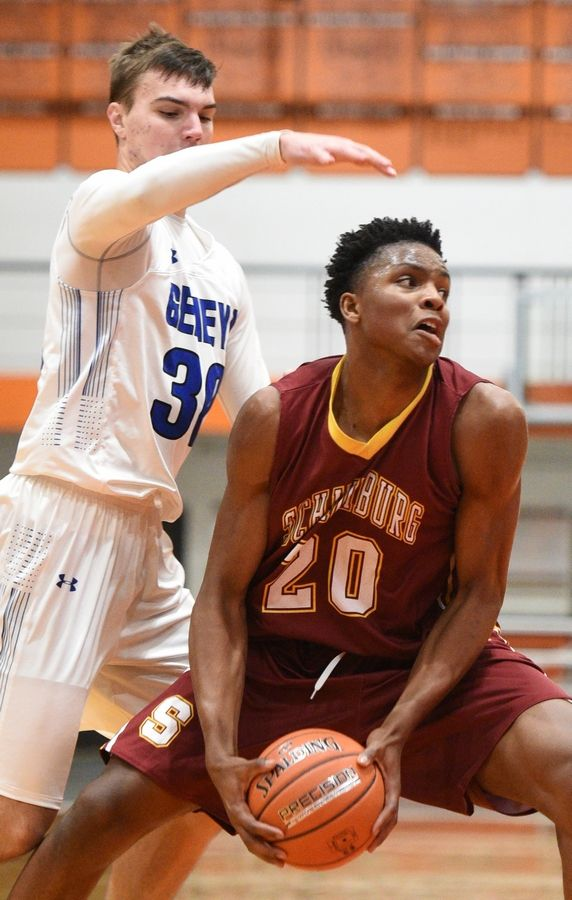Schaumburg's Chris Hodges looks for room to operate under the basket against Geneva last season.