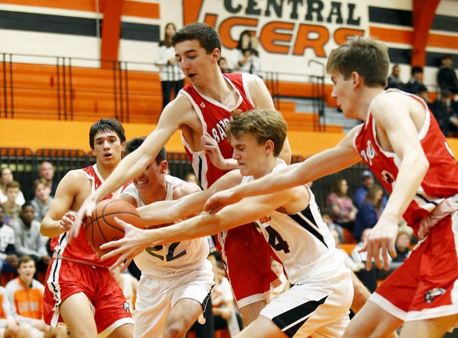 Barrington and Crystal Lake Central players fight for the loose ball during Monday's boys varsity basketball game in Crystal Lake.