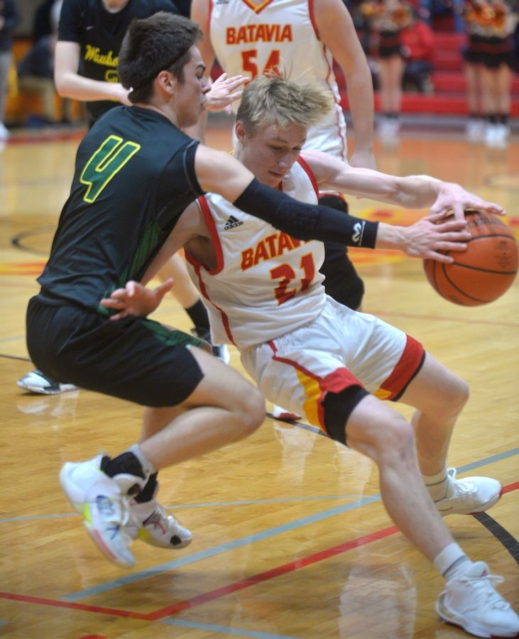 Waubonsie Valley guard Adri Malushi pressures Batavia guard Luke Fehrenbacher in the Ken Peddy Windmill City Classic Saturday Nov. 30 in Batavia.