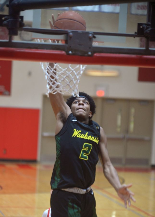 Waubonsie Valley guard Isaiah Smith dunks on a fast break against host Batavia Saturday in the Ken Peddy Windmill City Classic.