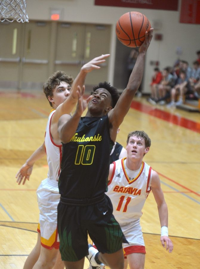 Waubonsie Valley forward Caleb Brackett puts up a shot defended by Batavia forward Ethan Ivan in the Ken Peddy Windmill City Classic Saturday in Batavia.
