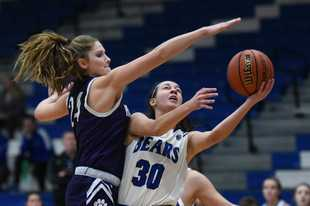 Lake Zurich's Alayna Soukup (30) heads to the basket under pressure by Hampshire's Kelby Bannerman during Tuesday's girls basketball game in Lake Zurich.