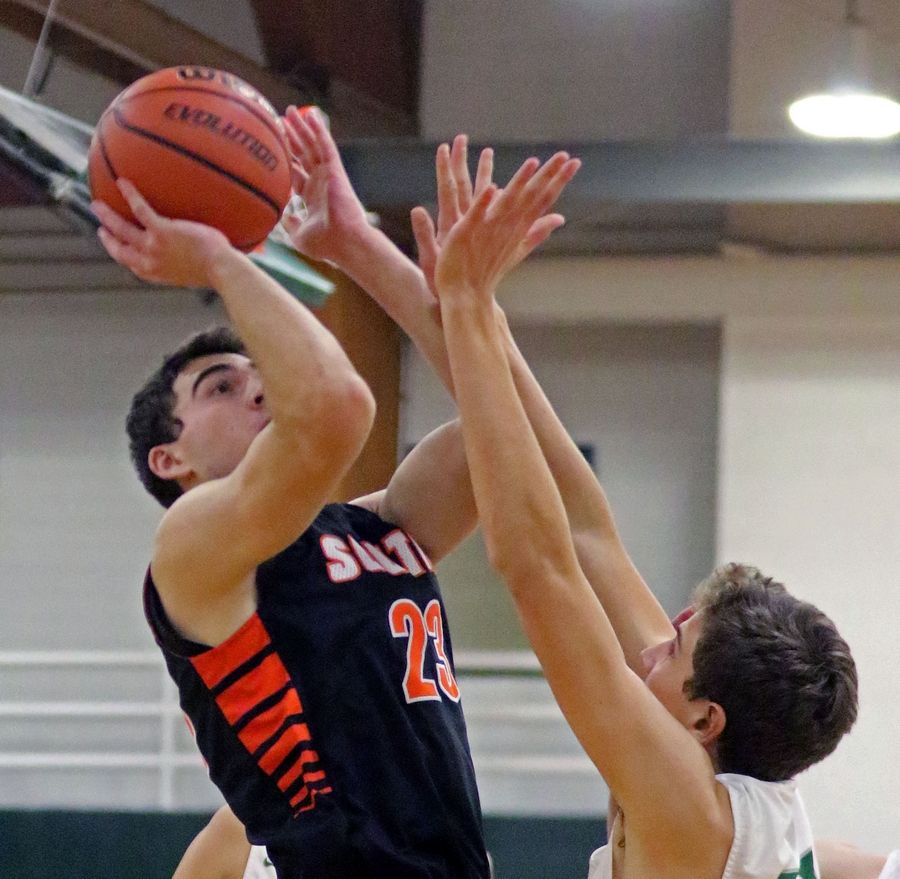 Wheaton Warrenville South's Tyler Fawcett takes a shot during a game at Glenbard West on Dec. 11.