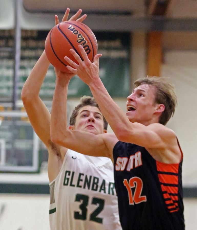 Wheaton Warrenville South's Ben Bastian takes a shot while defended by Glenbard West's Caden Pierce during a game in Glen Ellyn on Dec. 11.