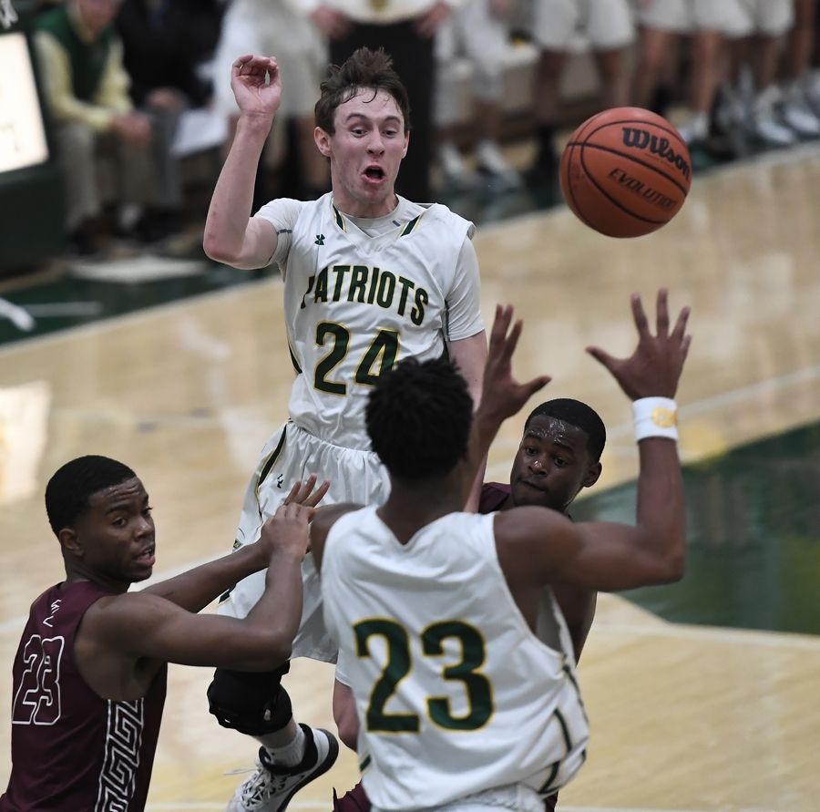 Stevenson's Matthew Ambrose passes the ball off to teammate Robert Holmes as Zion-Benton applies pressure in boys basketball at Stevenson on Friday.