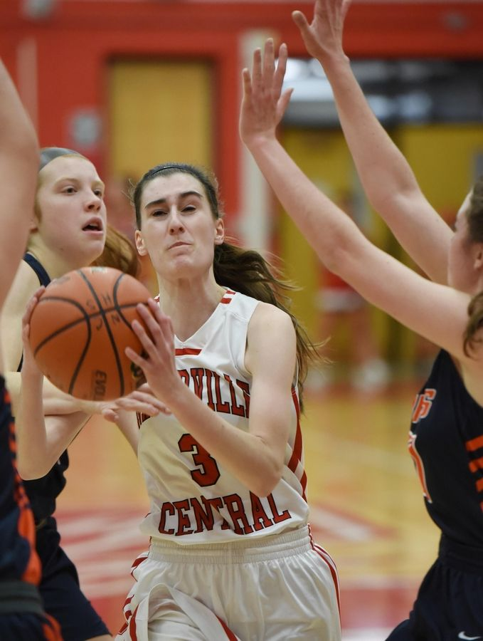 Naperville Central's Sara Opalka drives into the Naperville North defense in a basketball game in Naperville Friday.