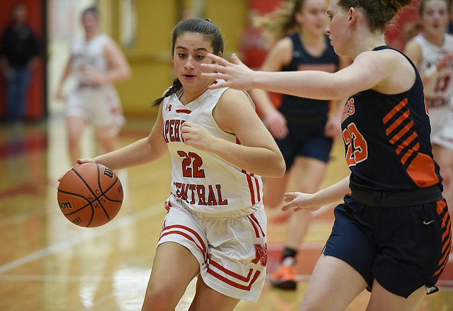 Naperville Central's Karly Maida drives against Naperville North's Peyton Fenner in a basketball game in Naperville Friday.