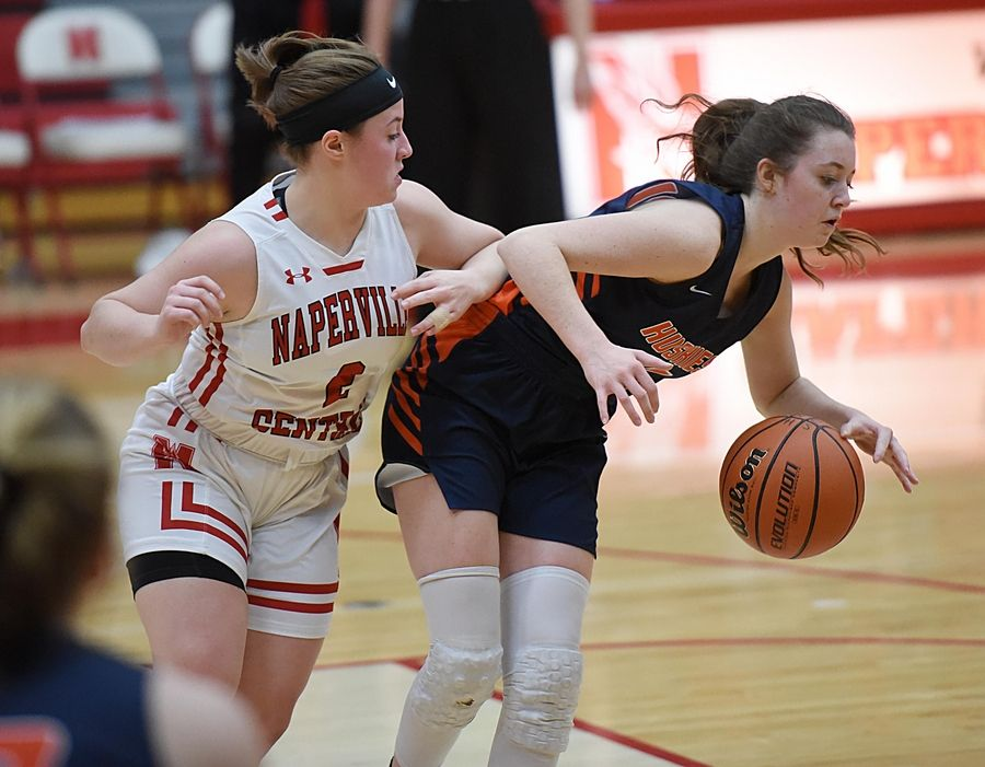 Naperville Central's Gabriella Melby bumps Naperville North's Abby Drendel in a basketball game in Naperville Friday.