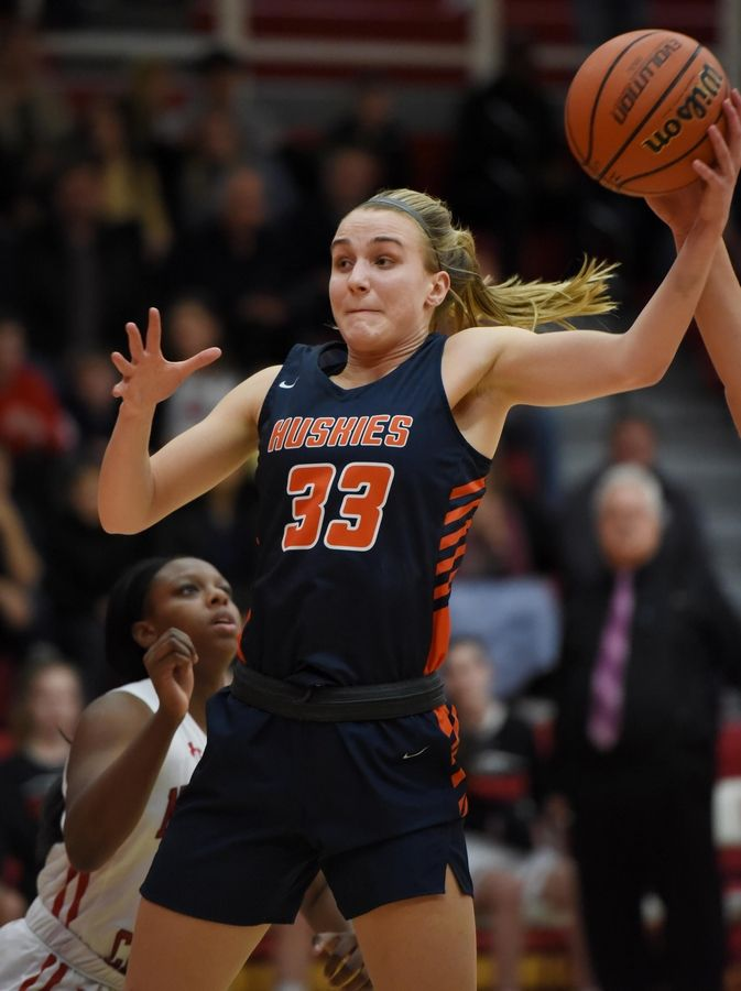 Naperville North's Greta Kampschroeder gets a rebound against Naperville Central in a basketball game in Naperville Friday.