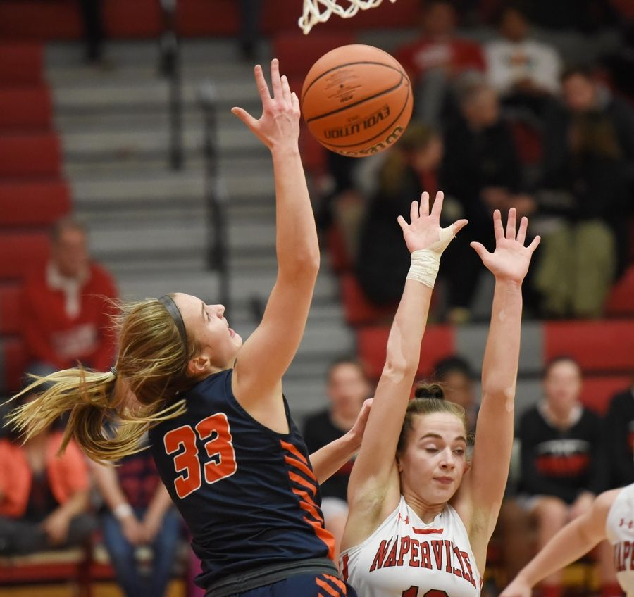 Naperville North's Greta Kampschroeder loses control of her shot against Naperville Central's Lauren Umbright in a basketball game in Naperville Friday.