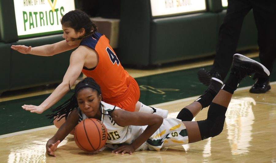 Stevenson's Simone Sawyer, lower, and Buffalo Grove's Macy Floro dive to the floor for a loose ball during Saturday's game in Lincolnshire.