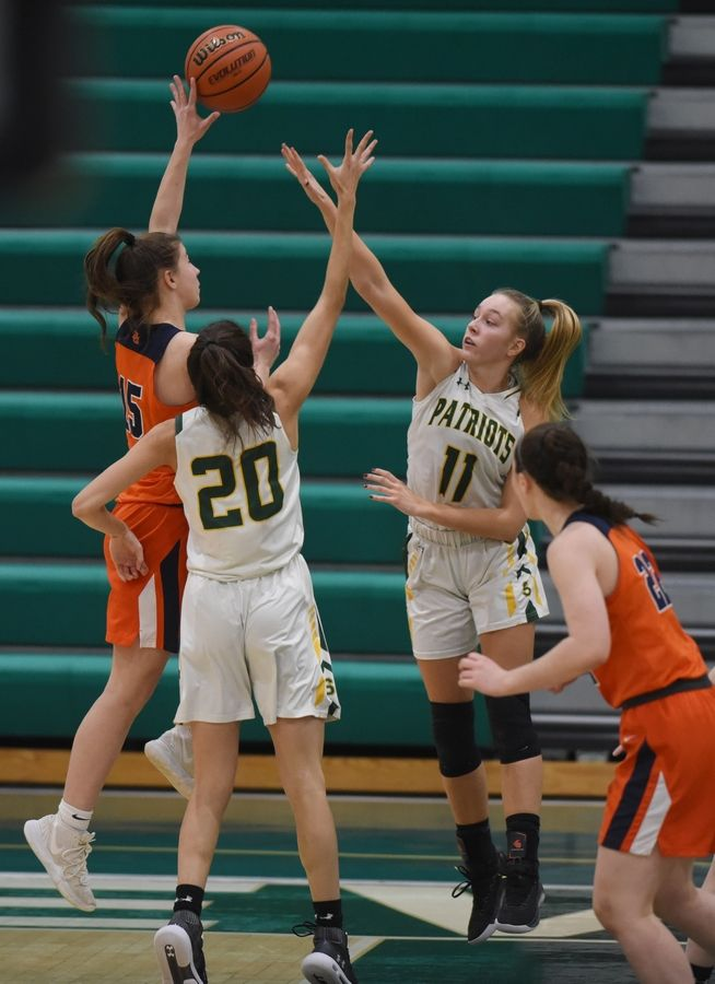 Buffalo Grove's Kora Kipley, left, shoots against the defense of Stevenson's Avery King, middle, and Nikki Kolz during Saturday's game in Lincolnshire.