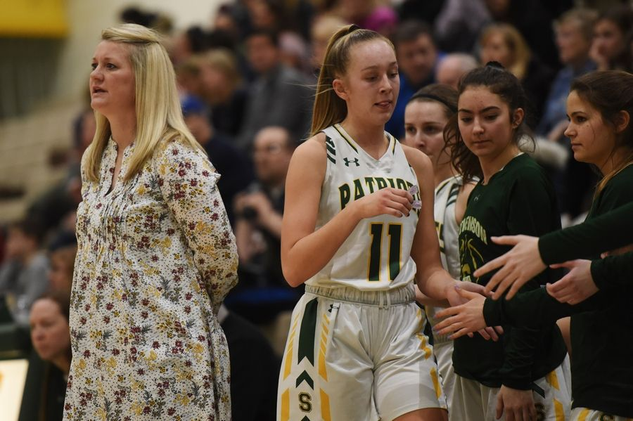 Stevenson girls basketball coach Ashley Graham leads her team during Saturday's game in Lincolnshire.