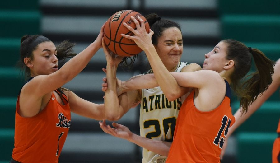 Buffalo Grove's Megan Fontanetta, left, and Kora Kipley, right, try to take the ball from Stevenson's Avery King during Saturday's game in Lincolnshire.