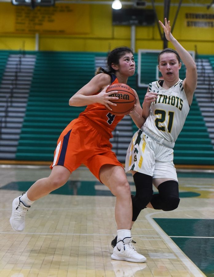 Buffalo Grove's Macy Floro drives to the basket against Stevenson's Lydia Lueck during Saturday's game in Lincolnshire.