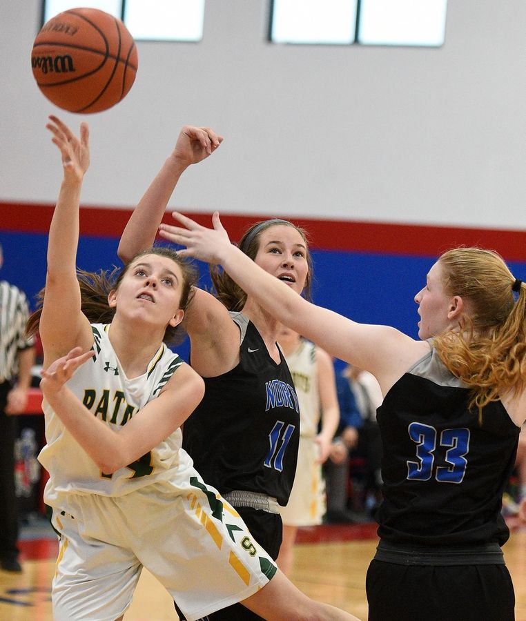 Stevenson's Ava Bardic lays up a shot with St. Charles North's Caroline Jakaitis (11) and Emma Nawara (33) defending at 37th annual Komaromy Classic girls basketball tournament at Dundee-Crown Thursday.