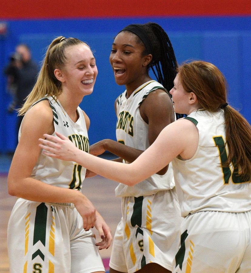 Stevenson's Nikki Kolz (11), Simone Sawayer (13) and Nikki Ware (10) celebrate a late basket as they pull away from St. Charles North at 37th annual Komaromy Classic girls basketball tournament at Dundee-Crown Thursday.