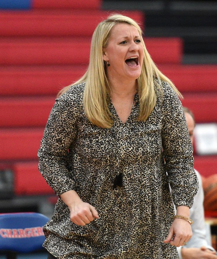 Stevenson head coach Ashley Graham cheers on her team as they pull away from St. Charles North at 37th annual Komaromy Classic girls basketball tournament at Dundee-Crown Thursday.