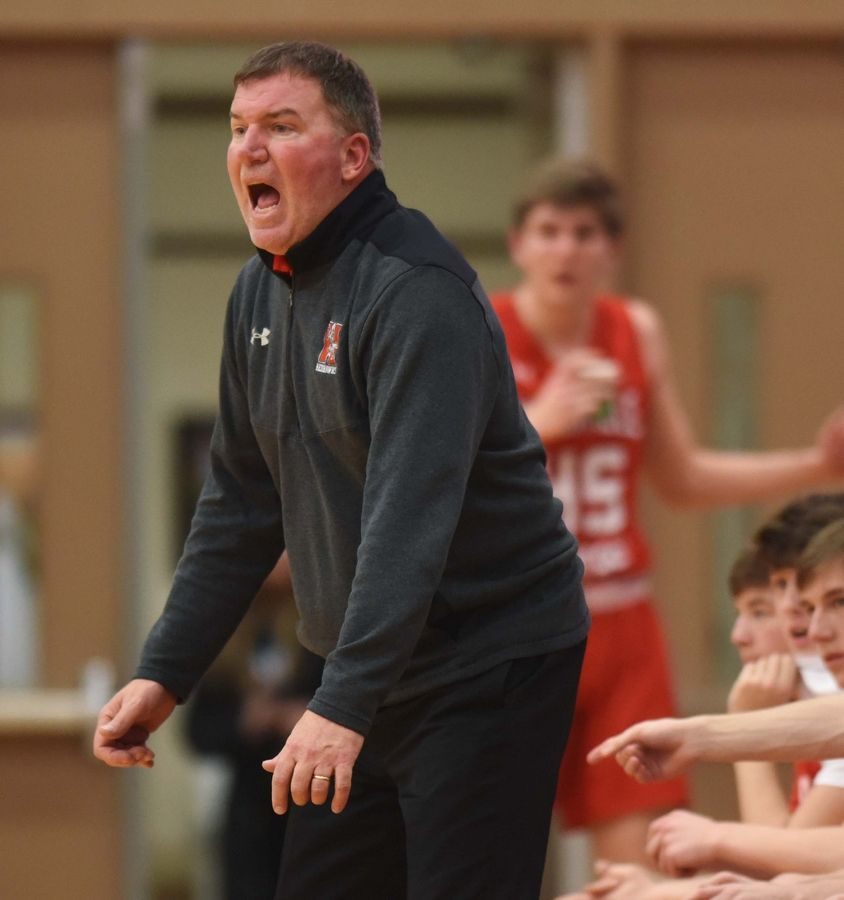 Naperville Central boys basketball coach Pete Kramer leads his team during Saturday's game in DeKalb.