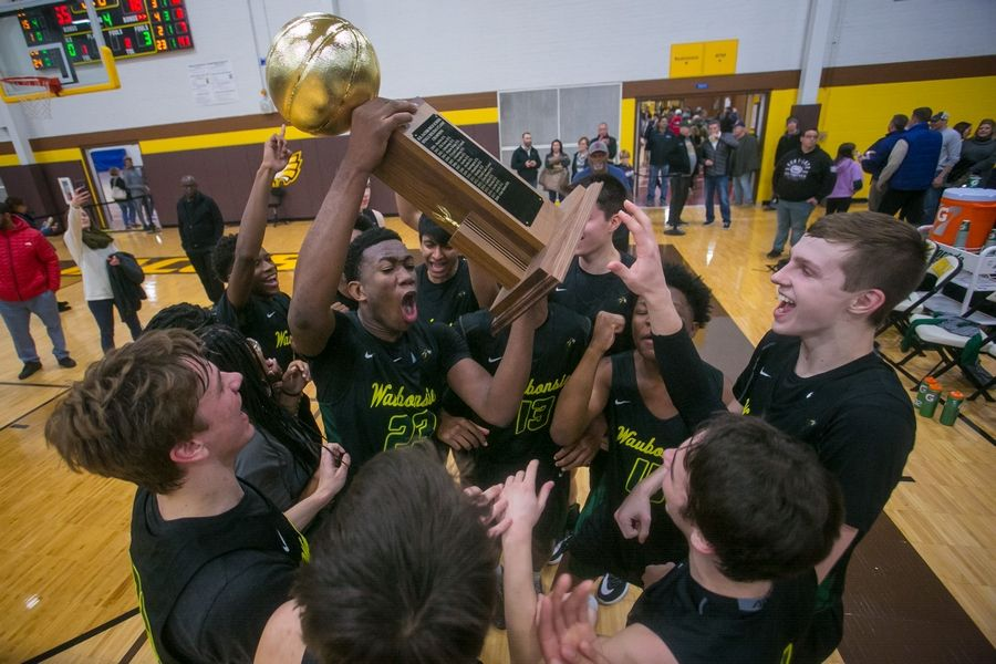 Waubonsie Valley guard/forward Marcus Skeete (23) celebrates winning the 20th Annual Hinkle Holiday Classic championship with teammates after the game at Harry D. Jacobs High School on Saturday, Dec. 28, 2019, in Algonquin, Ill. Waubonsie Valley won, 78-65.