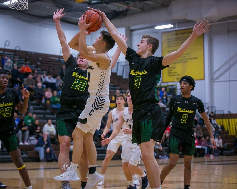 Waubonsie Valley guard/forward Ben Schwieger (3) blocks a shot attempt by Cary-Grove guard Beau Frericks (2) in the fourth quarter of the 20th Annual Hinkle Holiday Classic championship game at Harry D. Jacobs High School on Saturday, Dec. 28, 2019, in Algonquin, Ill. Waubonsie Valley won, 78-65.