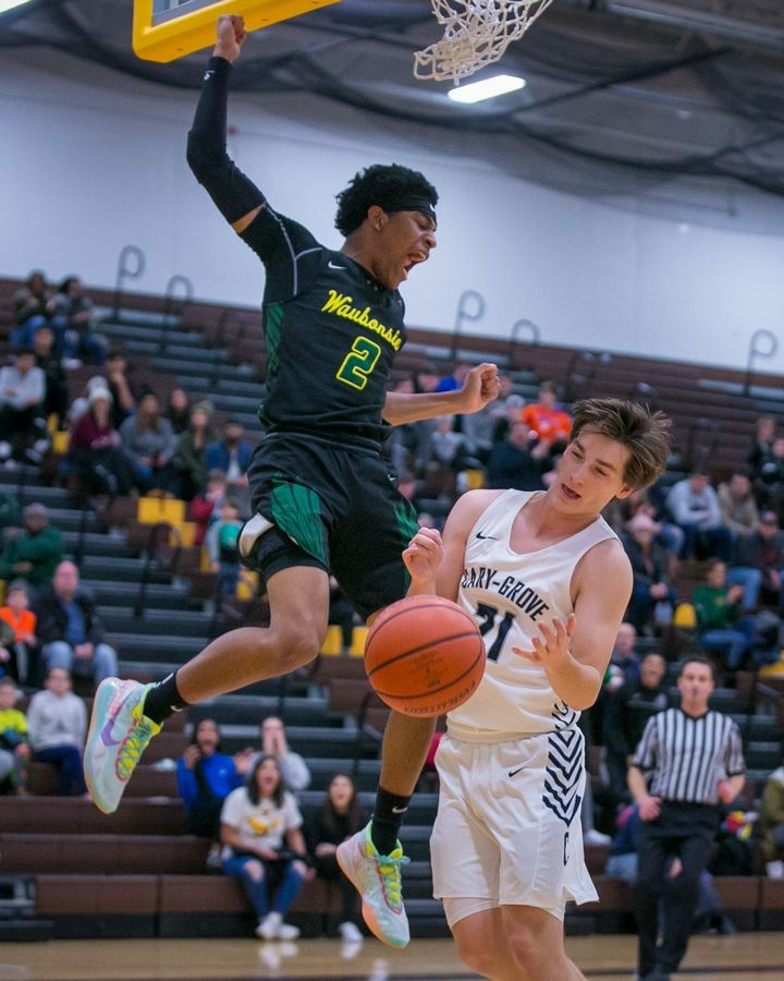 Waubonsie Valley guard Isaiah Smith (2) celebrates as he finishes a dunk past Cary-Grove guard Ryan Weaver (21) in the second quarter of the 20th Annual Hinkle Holiday Classic championship game at Harry D. Jacobs High School on Saturday, Dec. 28, 2019, in Algonquin, Ill. Waubonsie Valley won, 78-65.