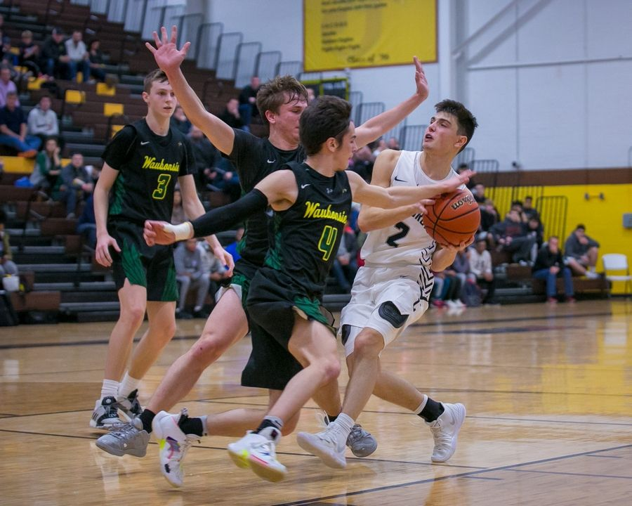Waubonsie Valley guard Adri Malushi (4) pokes away the ball as Cary-Grove guard Beau Frericks (2) attempts to drive to the basket in the fourth quarter of the 20th Annual Hinkle Holiday Classic championship game at Harry D. Jacobs High School on Saturday, Dec. 28, 2019, in Algonquin, Ill. Waubonsie Valley won, 78-65.