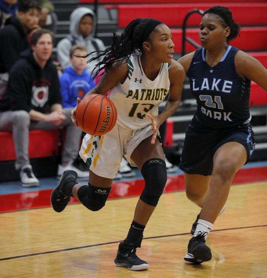 Stevenson's Simone Sawyer, left, moves the ball past Lake Park's Darrione Rogers in the third place game of the Komaromy Holiday Classic at Dundee-Crown High School in Carpentersville Monday.