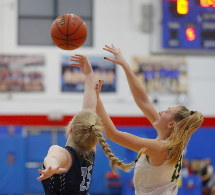 Stevenson's Nikki Kolz, right, battles Lake Park's Eleanor Helm for the ball in the third place game of the Komaromy Holiday Classic at Dundee-Crown High School in Carpentersville Monday.