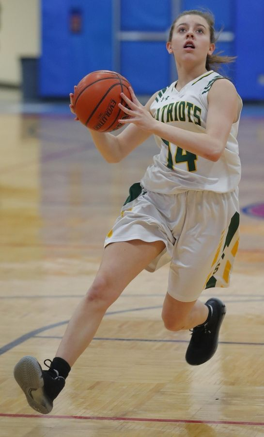 Stevenson's Ava Bardic drives against Lake Park in the third place game of the Komaromy Holiday Classic at Dundee-Crown High School in Carpentersville Monday.