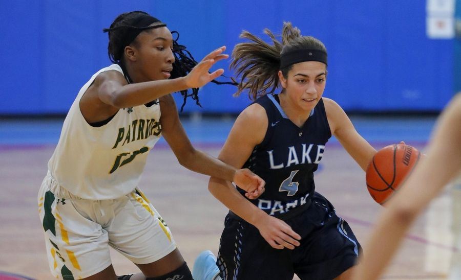 Stevenson's Simone Sawyer, left, guards Lake Park's Sara Balli in the third place game of the Komaromy Holiday Classic at Dundee-Crown High School in Carpentersville Monday.