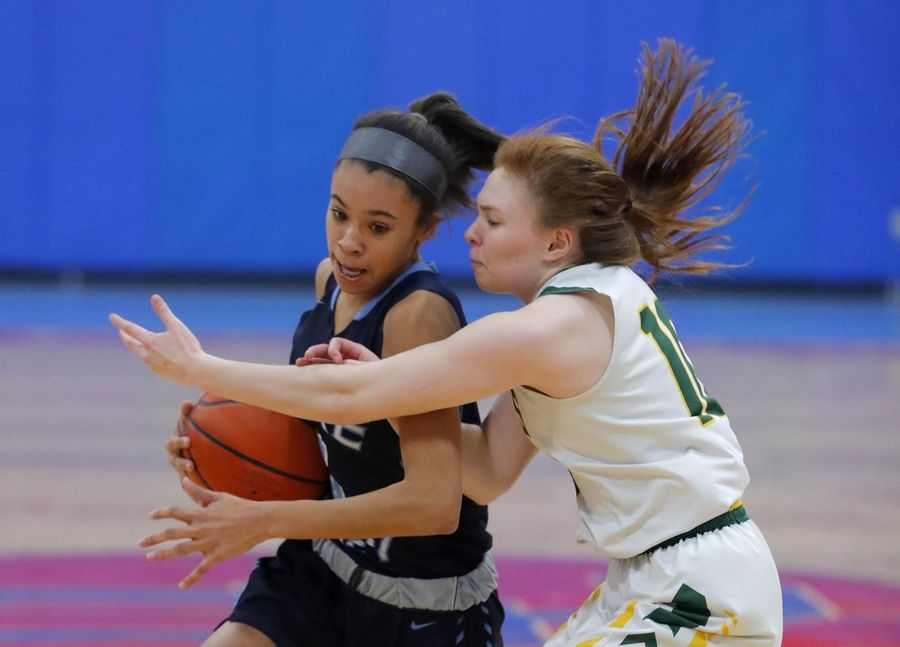 Stevenson's Nikki Ware, right, guards Lake Park's Gabrielle Burgess in the third place game of the Komaromy Holiday Classic at Dundee-Crown High School in Carpentersville Monday.