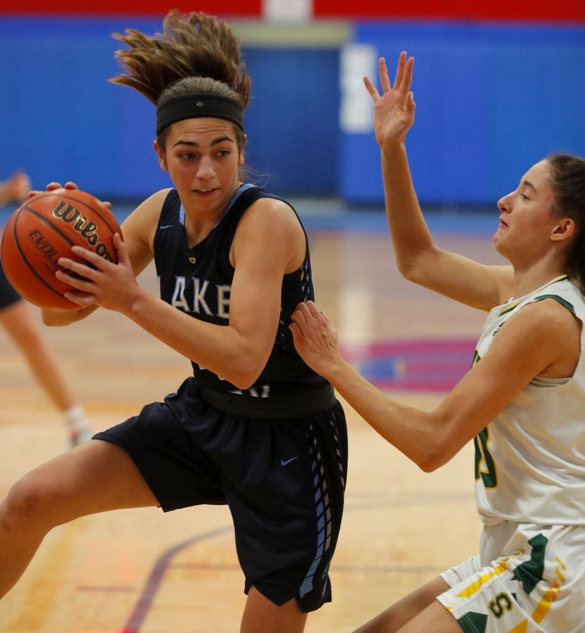 Lake Park's Sara Balli grabs a rebound in the third place game of the Komaromy Holiday Classic at Dundee-Crown High School in Carpentersville Monday.