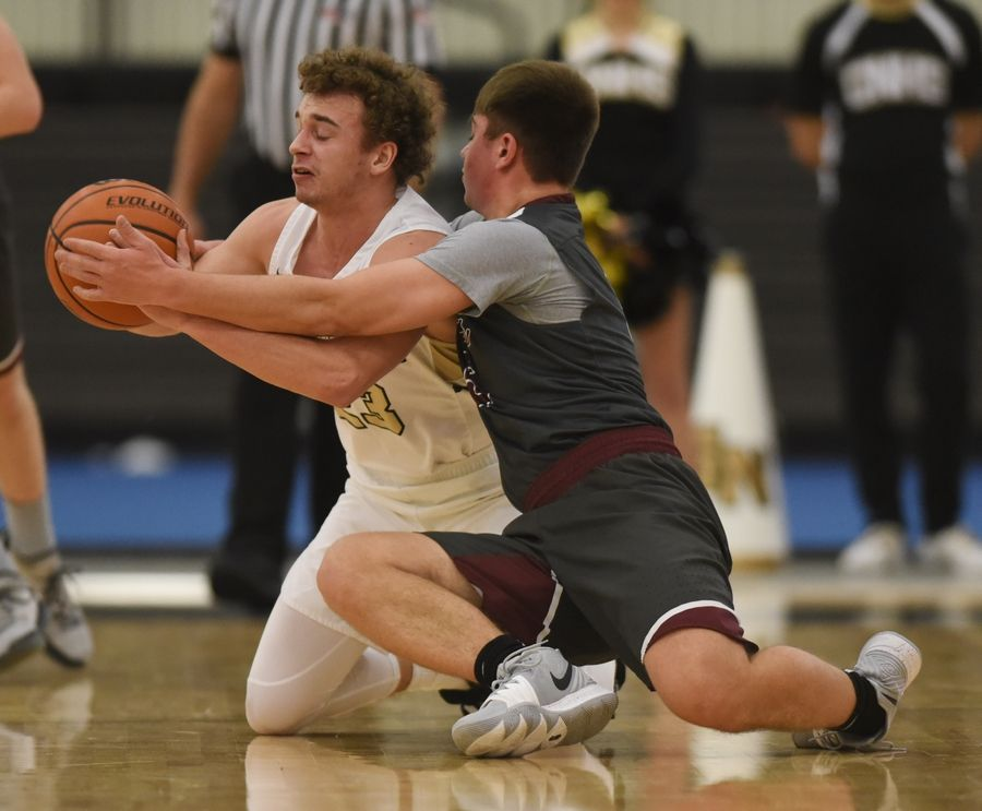 Grayslake North's Jason Donohue, left, gets fouled as he goes to the floor for a loose ball with Prairie Ridge's Luke Wolf during Saturday's game in Grayslake.