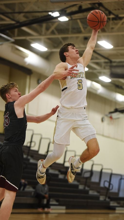 Grayslake North's Joe Swanson drives toward the basket against Prairie Ridge defender Taidhgin Trost during Saturday's game in Grayslake.