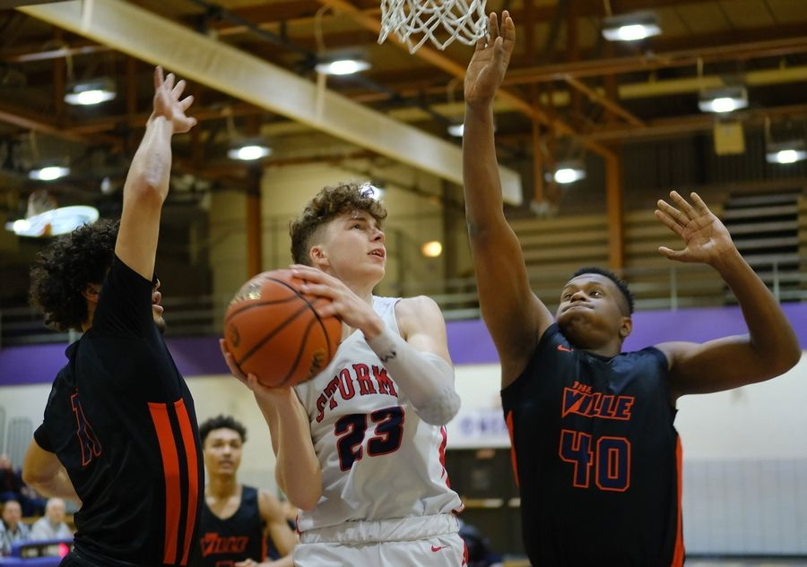 South Elgin's Lane Mcvicar (23) goes to the hoop as Romeoville's Trayton Trice (40) defends on Saturday, Jan. 11 in Downers Grove.