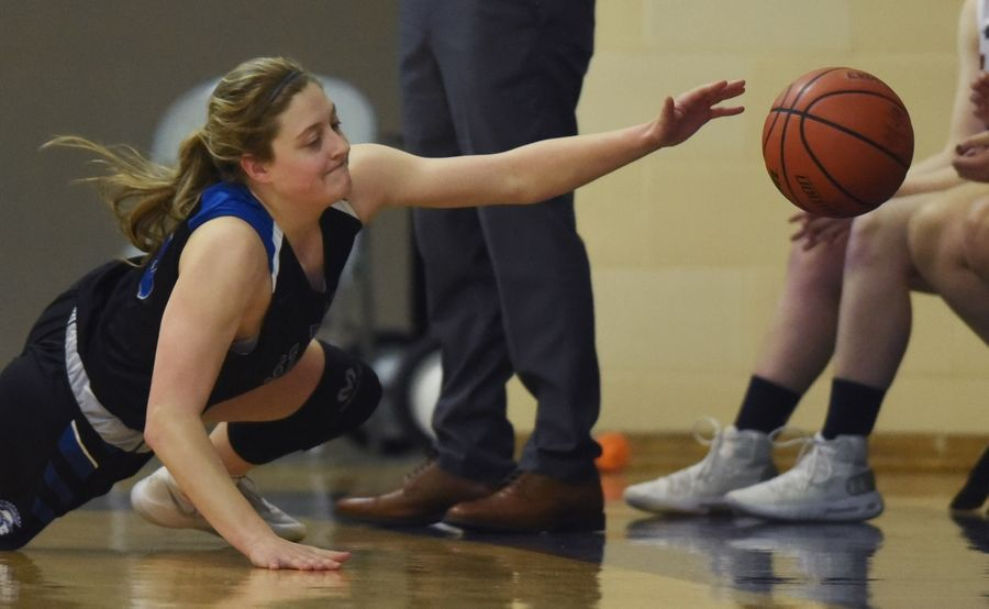 St. Francis' Maggie Culver dives to the floor while attempting to keep the ball in bounds during Saturday's game against St. Viator in Arlington Heights.