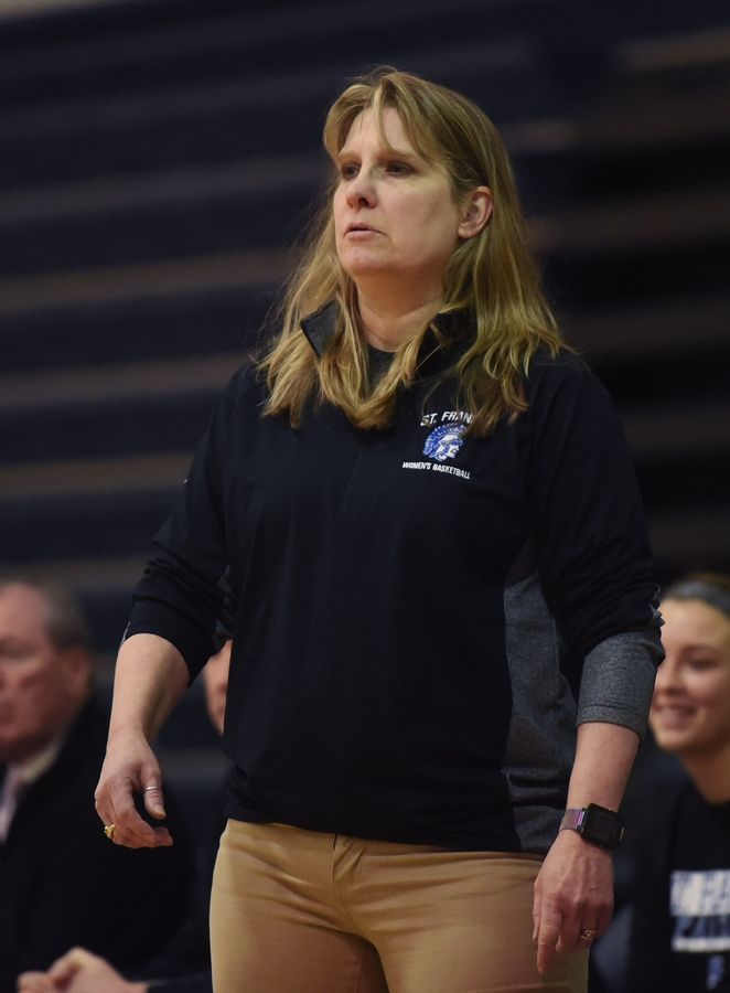 St. Francis girls basketball coach Sandy De Craene watches her team from the sideline during Saturday's game against St. Viator.