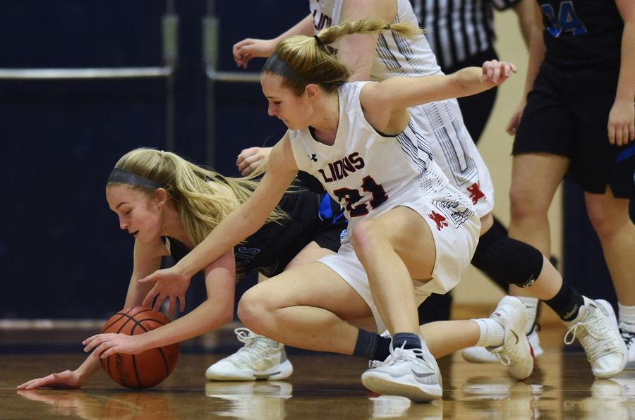 St. Francis' Lauren Bruce, left, and St. Viator's Kate Peterson go to the floor for a loose ball during Saturday's game in Arlington Heights.