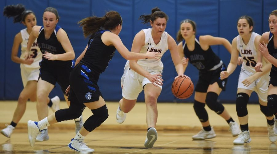 St. Viator's Aubrey Horbach leads a fast break as St. Francis' Kate Chaparro defends during Saturday's game in Arlington Heights.