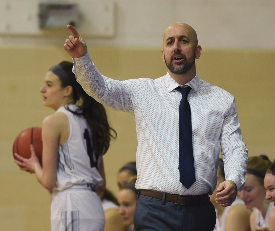 St. Viator girls basketball coach Jason Raymond leads his team during Saturday's game against St. Francis.