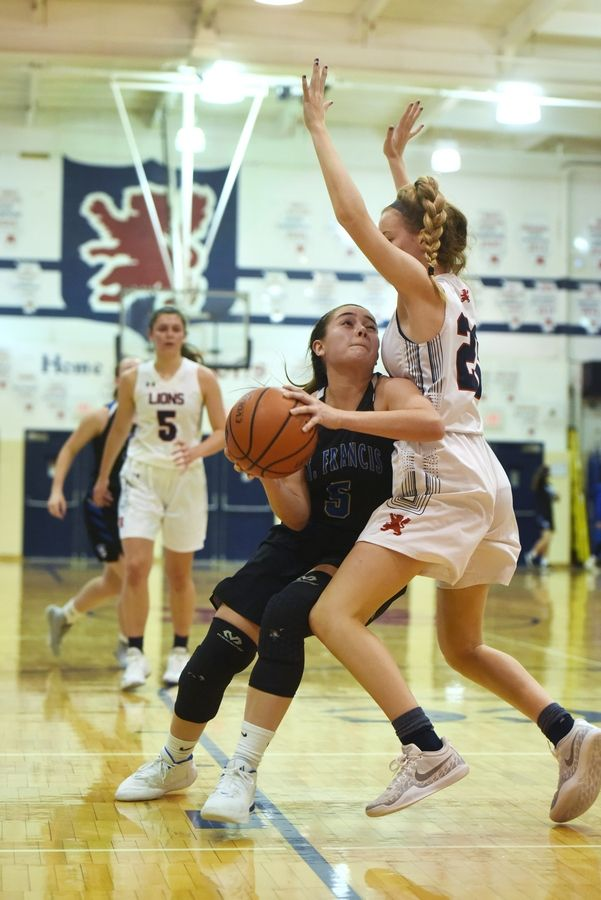 St. Francis' Kate Chaparro, left, tries to make her way past St. Viator's Caroline Sexton during Saturday's game in Arlington Heights.