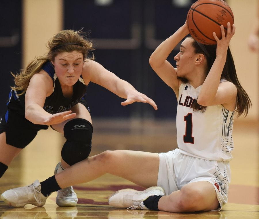 St. Francis' Maggie Culver, left, lunges as she attempts to prevent St. Viator's Nora Ahram from making a pass during Saturday's game in Arlington Heights.