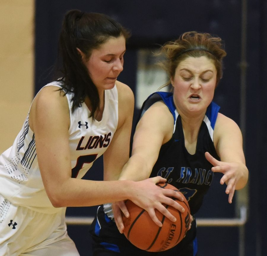 St. Viator's Aubrey Horbach, left, and St. Francis' Maggie Culver each try to grab the ball near the basket during Saturday's game in Arlington Heights.
